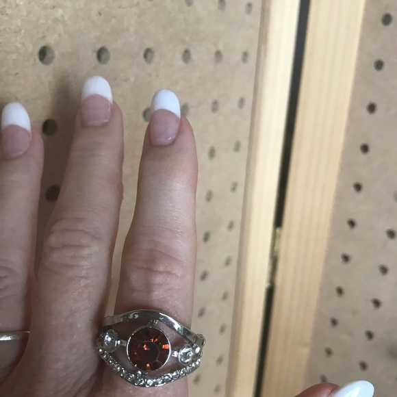 Double tiered silver ring with round center stone